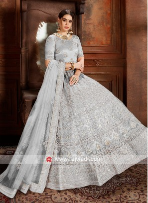 Grey color Lehenga choli with matching dupatta.