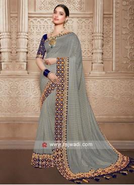Grey saree with navy blue blouse