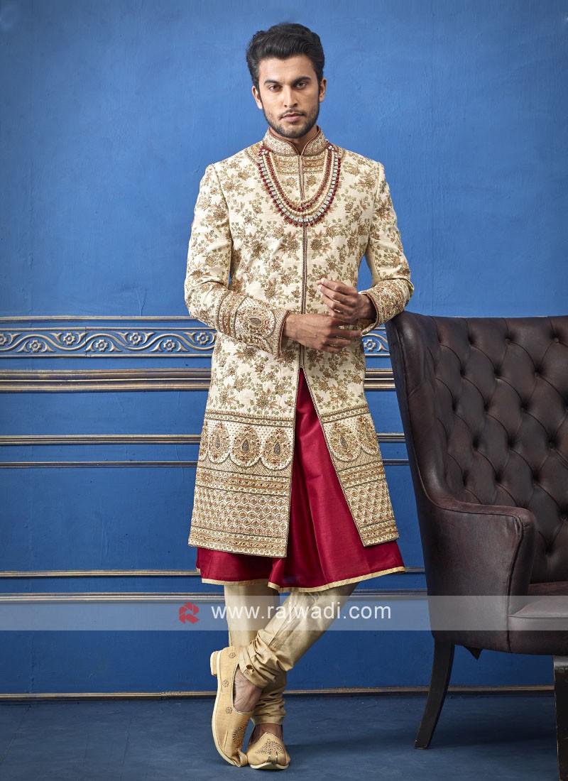 groom cream and red sherwani