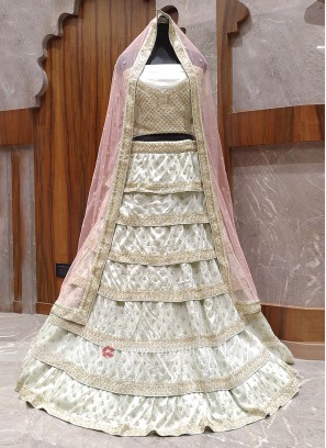 Ivory color layer bridal lehenga choli