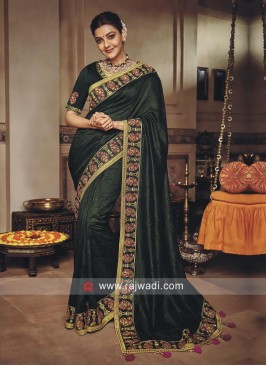 Kajal Aggarwal in Dark Green Saree