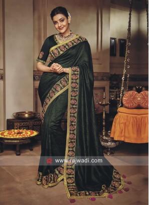 Kajal Aggarwal in Dark Green Saree