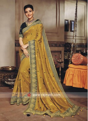 Kajal Aggarwal in Goldenrod Embroidered Saree