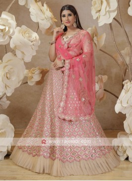 lehenga choli in pink and cream color