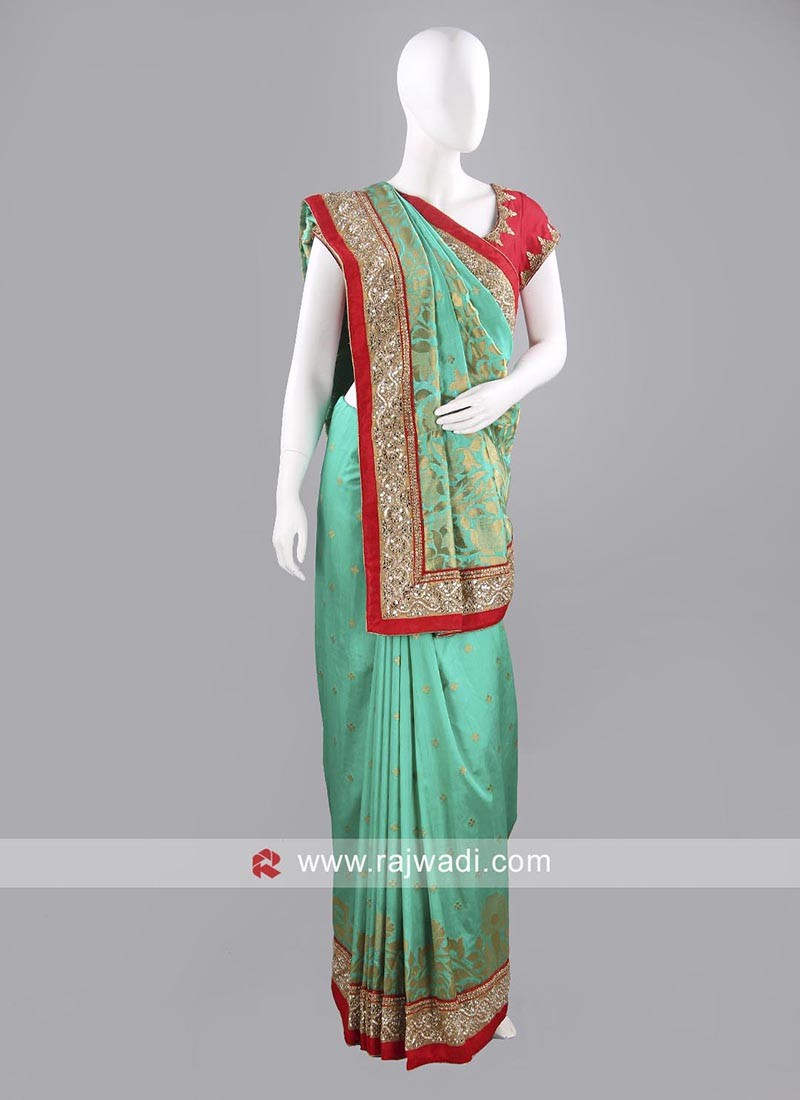 Light Green Saree with Red Border