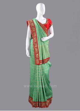 Light Green Sari with Dark Red Blouse Piece