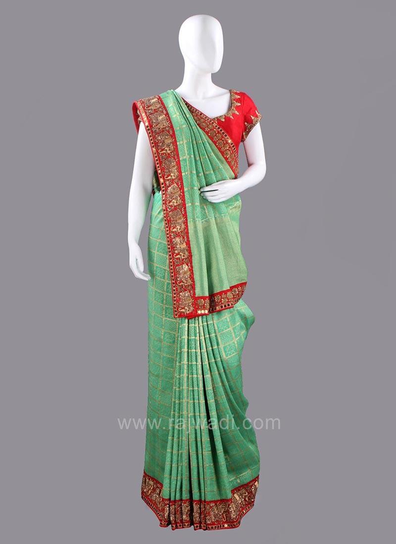Light Green Sari with Dark Red Blouse Piece