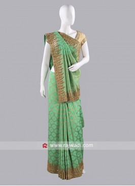 Light Green Sari with Golden Border