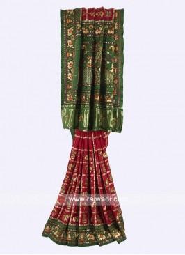 Maroon and green color gharchola saree