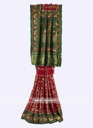 Maroon and green color gharchola saree