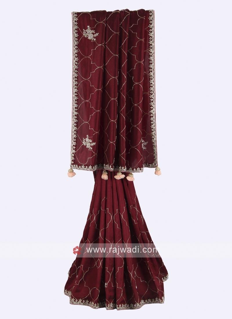 Maroon color pure silk saree