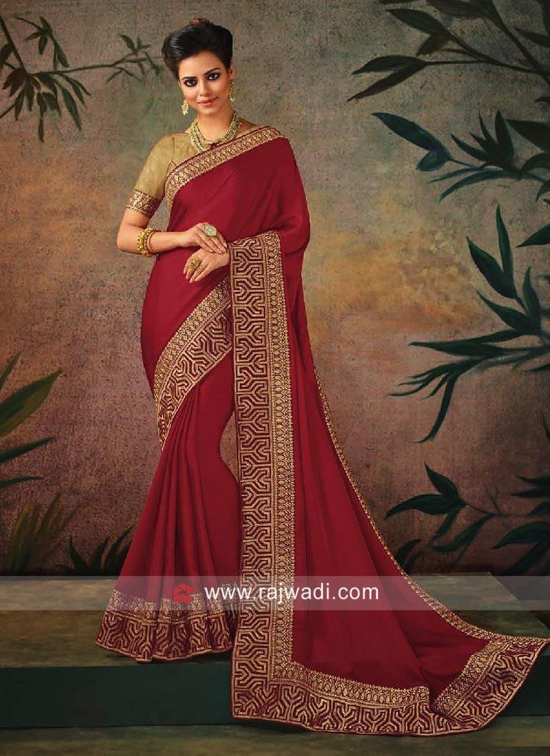 Maroon Designer Sari with Golden Blouse