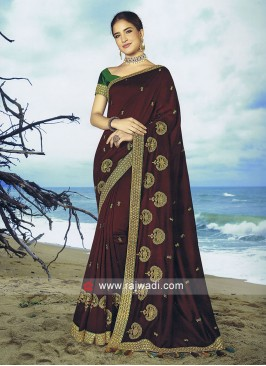 Maroon Raw silk saree with contrast blouse.