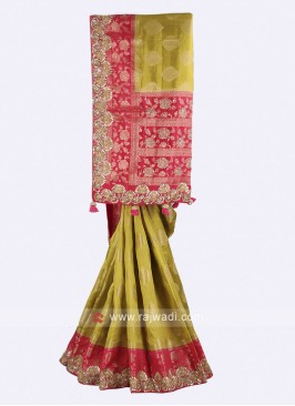 Mehndi green and pink color banarasi silk saree