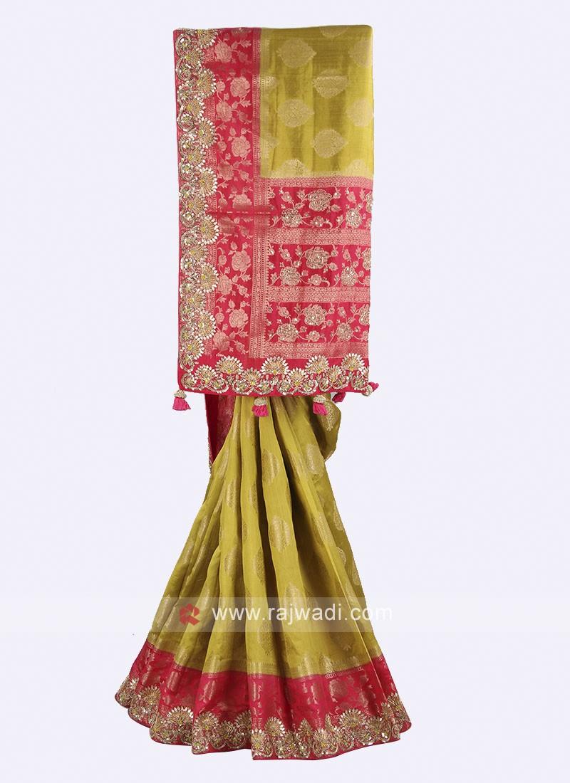 Mehndi green and pink color banarasi silk saree