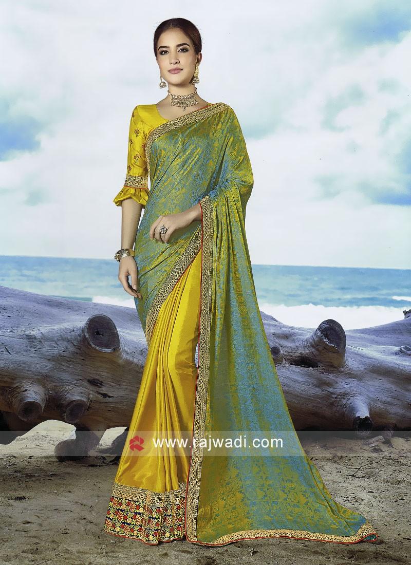 Mustard yellow and green Art Jacquard Silk  saree with blouse.