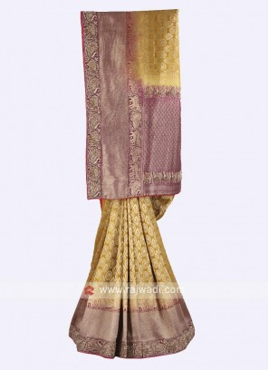 Mustard yellow and magenta color banarasi silk saree