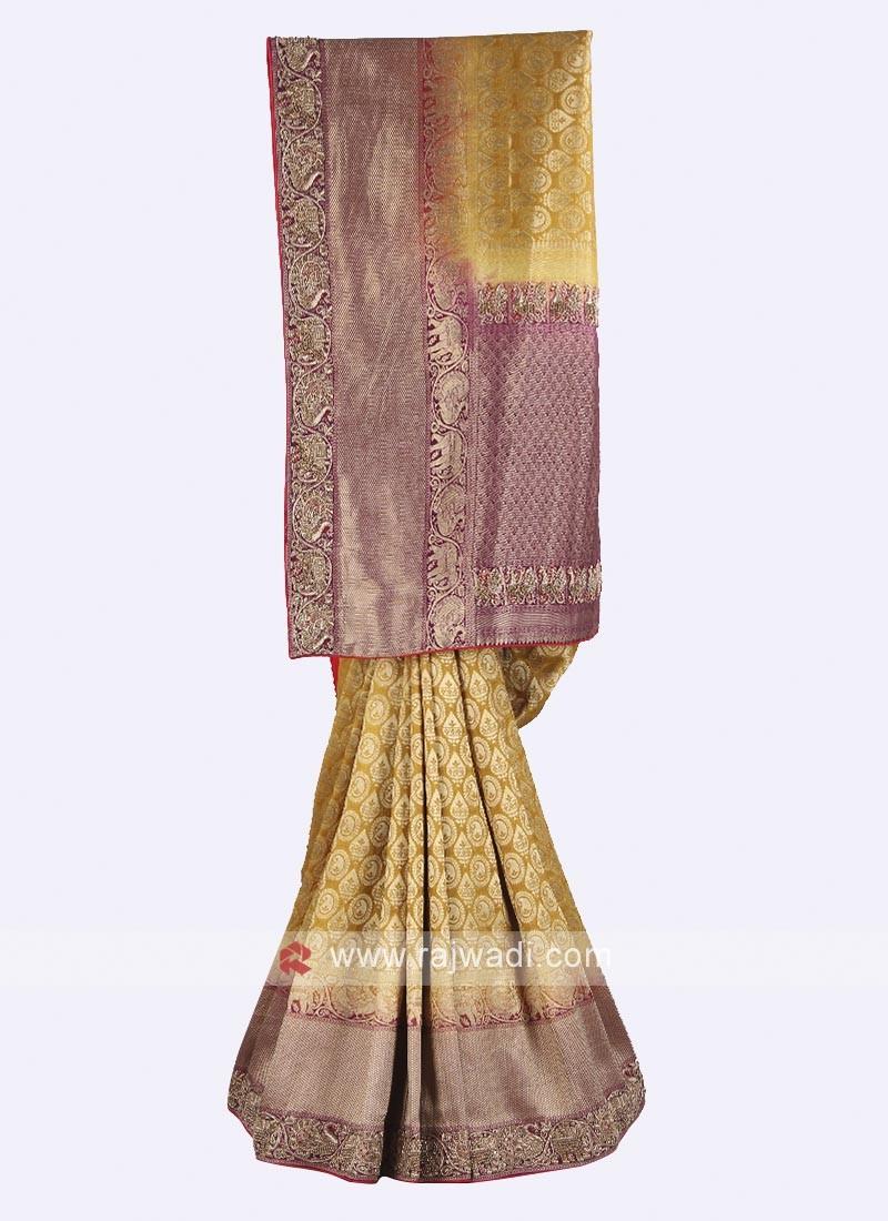 Mustard yellow and magenta color banarasi silk saree