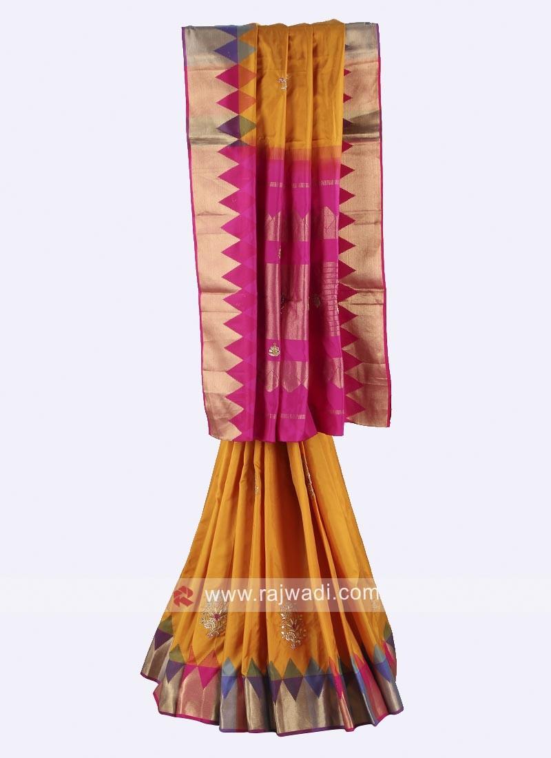 Mustard yellow and rani color pure silk saree