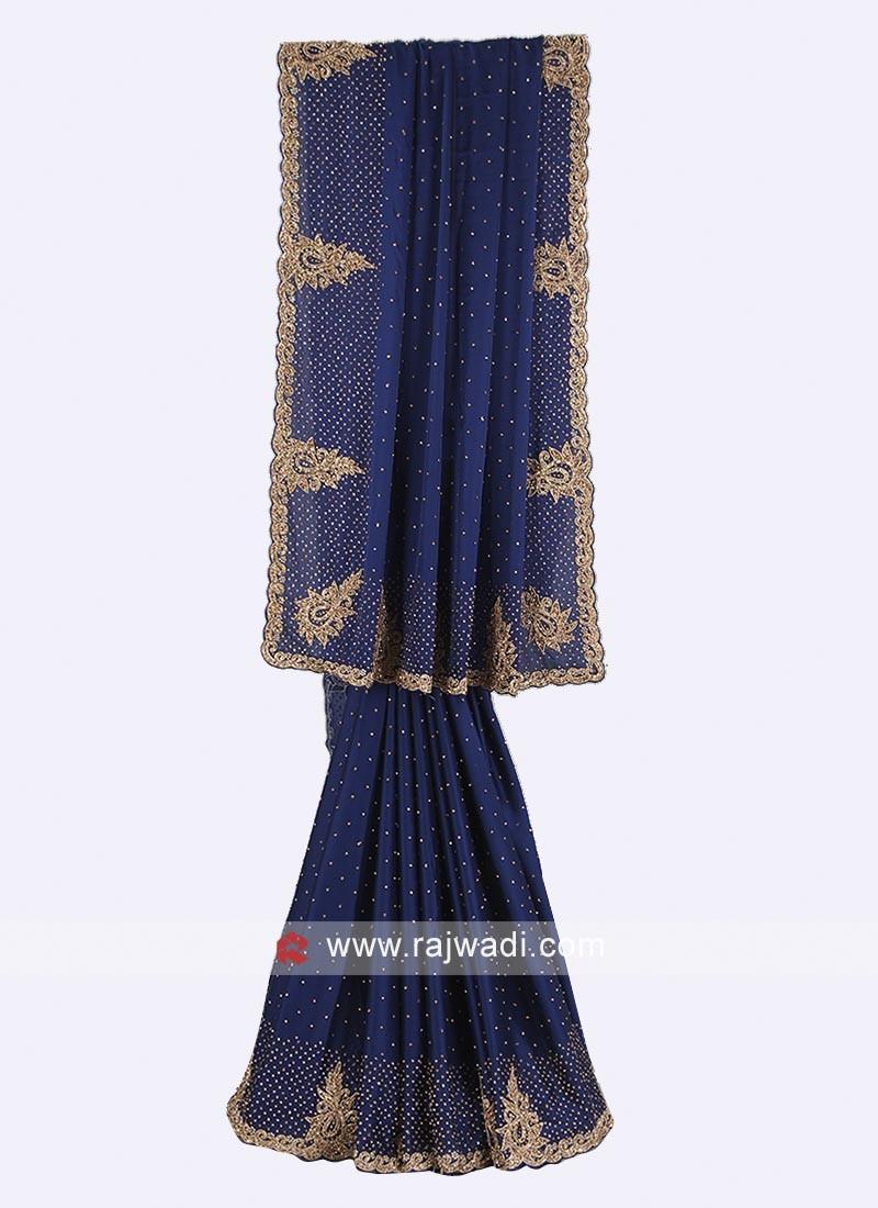 Navy blue color satin silk saree.