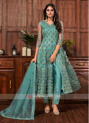 Net dress material in turquoise color
