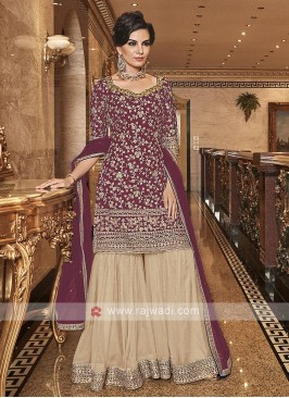 Net Embroidered Gharara Suit In Rani Color