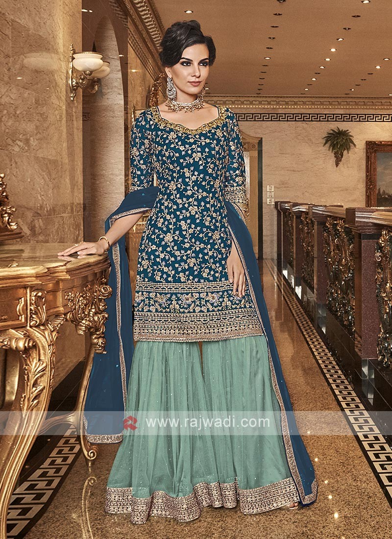 Net Embroidered Gharara Suit In Teal Color