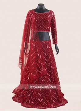 Net Heavy Embroidered Bride Lehenga Choli in Red