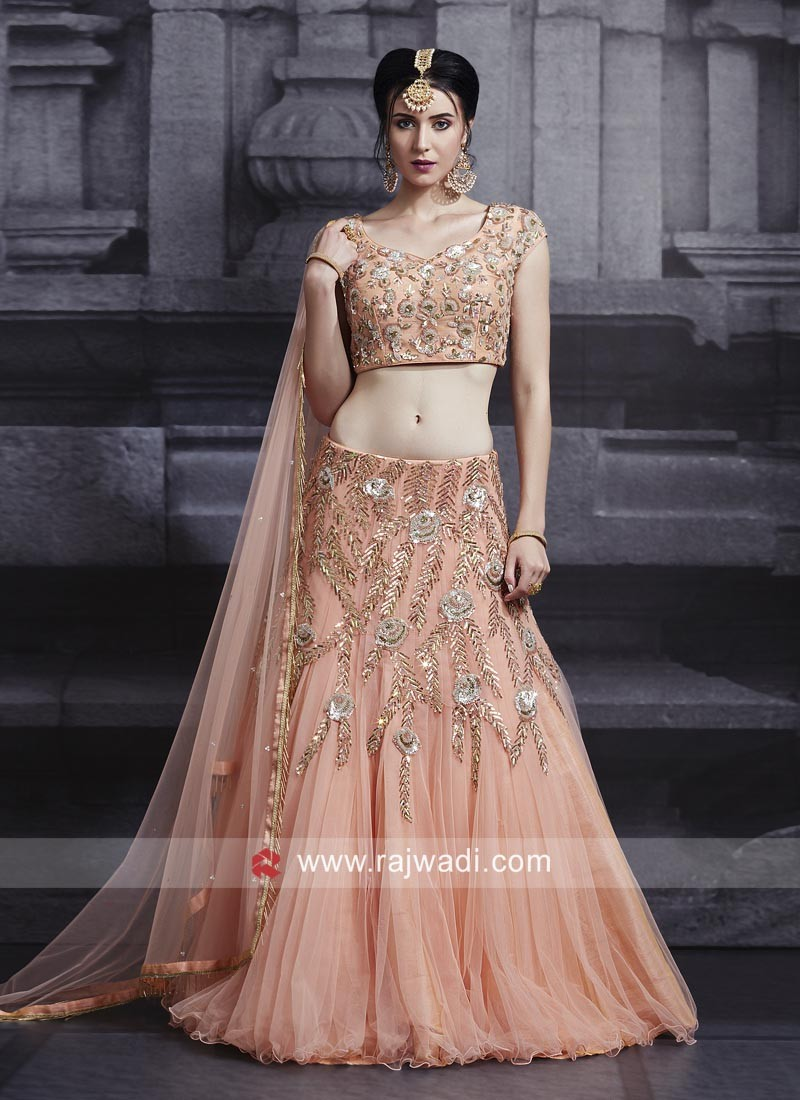 Net Heavy Embroidered Lehenga in Peach