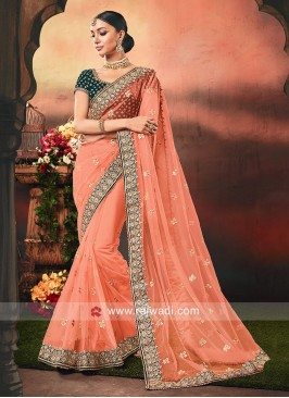 Net Orange Saree with Velvet Blouse