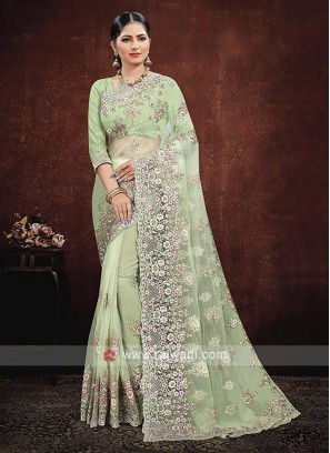 Net Saree In Pista Green Color