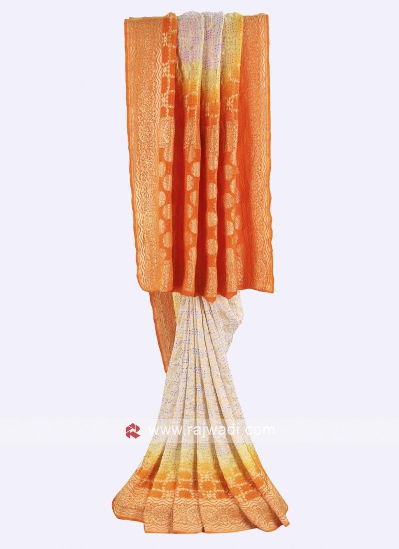 Off white and orange chiffon saree
