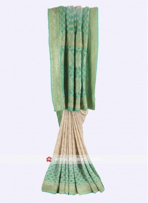 Off-white and pista green chiffon saree