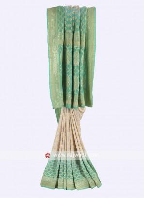 Off-white and pista green chiffon saree