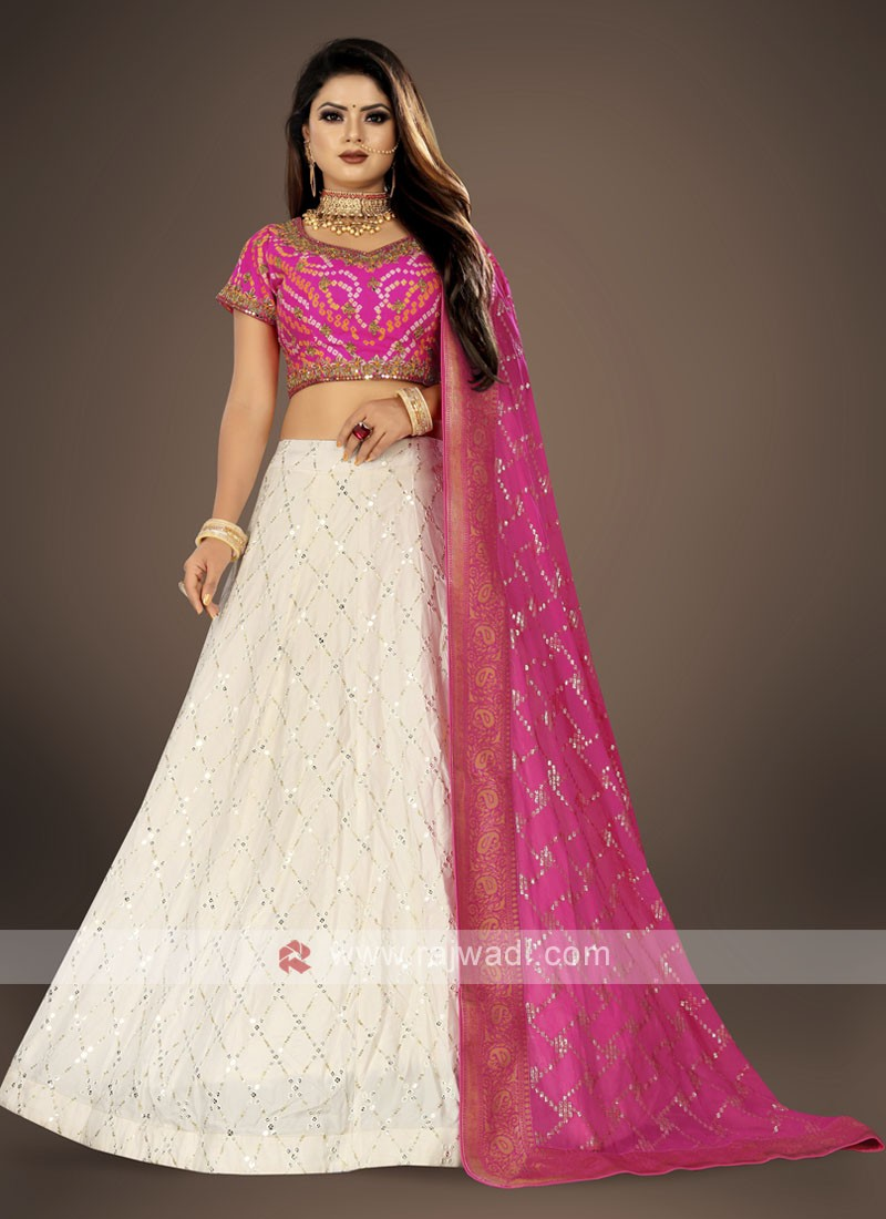 off white and rani color lehenga choli suit