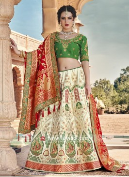 Off white, green and red lehenga choli