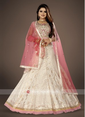 off white lehenga choli suit with pink dupatta