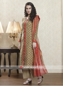 Skin and orange color salwar suit with dupatta.