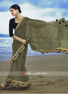 Olive drab art silk saree with contrast blouse.