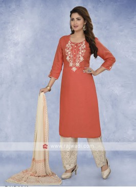 Orange and cream color salwar kameez
