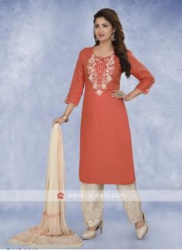 Orange and cream color salwar kameez