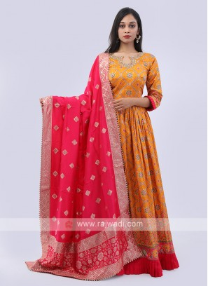 Orange and rani anarkali suit