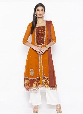 Orange and white colour salwar suit