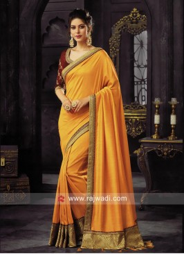Orange Border Work Saree with Tassels