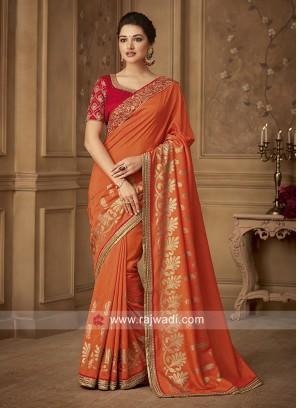 Orange Foil Print Saree with Red Blouse