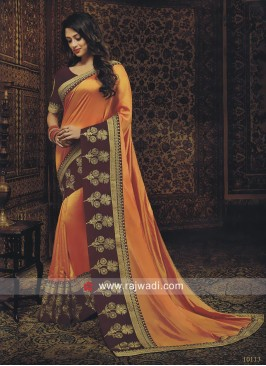 Orange Saree with Purple Blouse