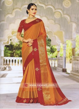 Orange Saree with Red Embroidered Blouse