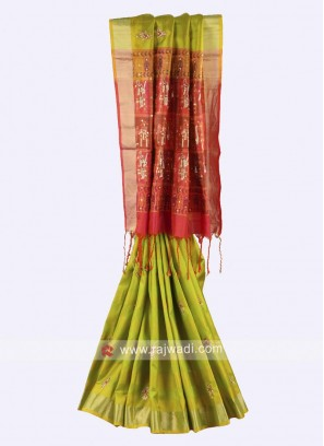 Parrot green and crimson color pure silk saree