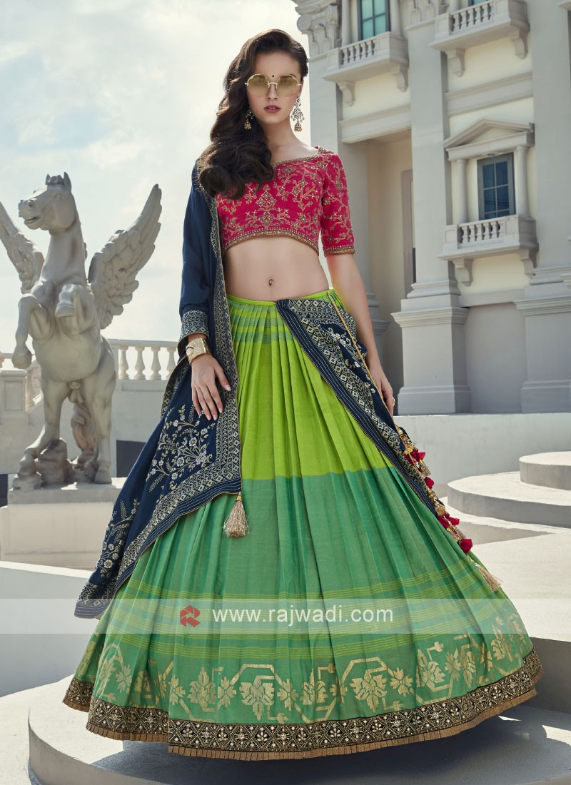 Parrot green and rani silk choli suit