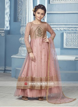Peach Anarkali with matching Salwar and net dupatta.